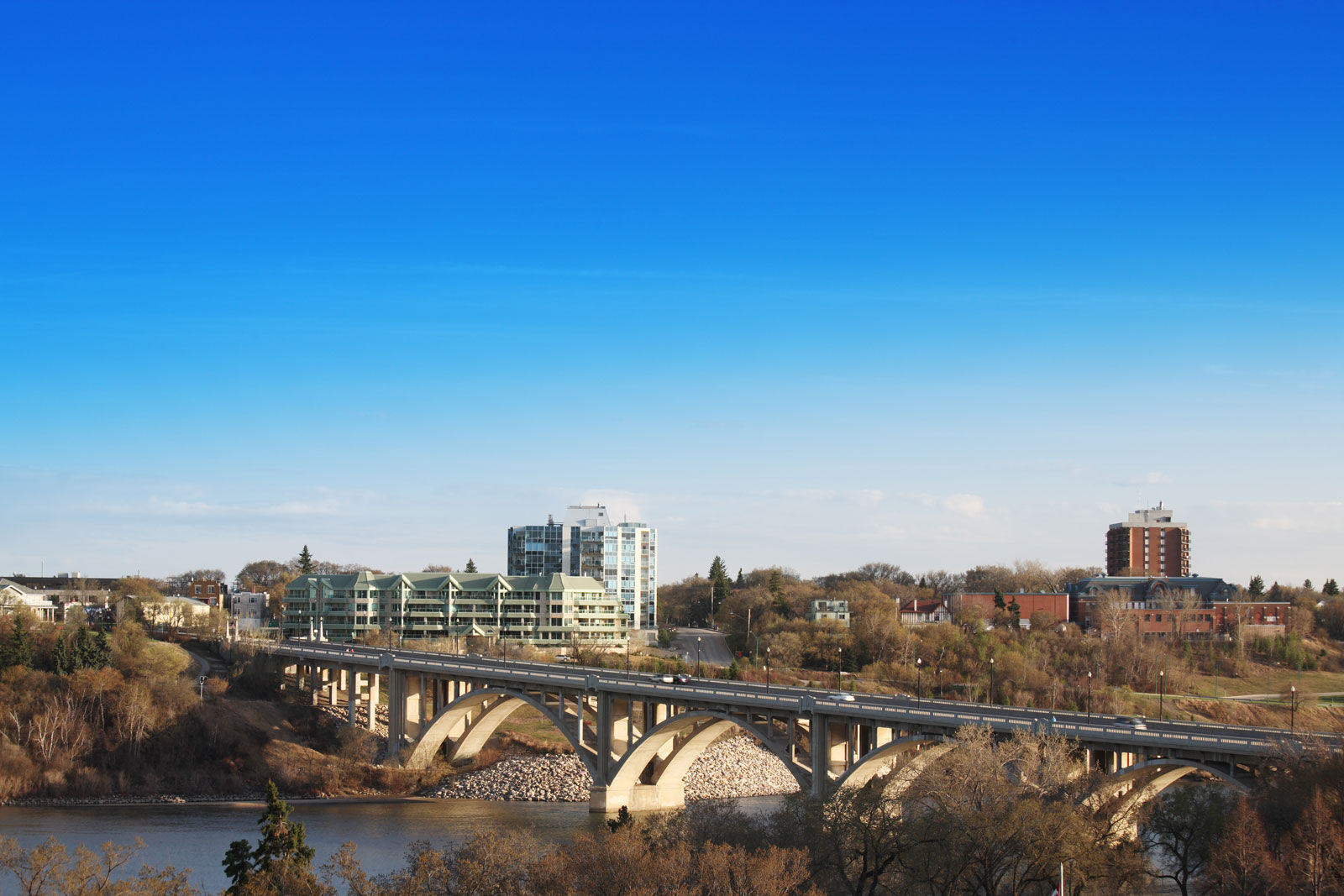 Enjoy a walk along the South Saskatchewan River from our Saskatoon hotel on a sunny day in spring.